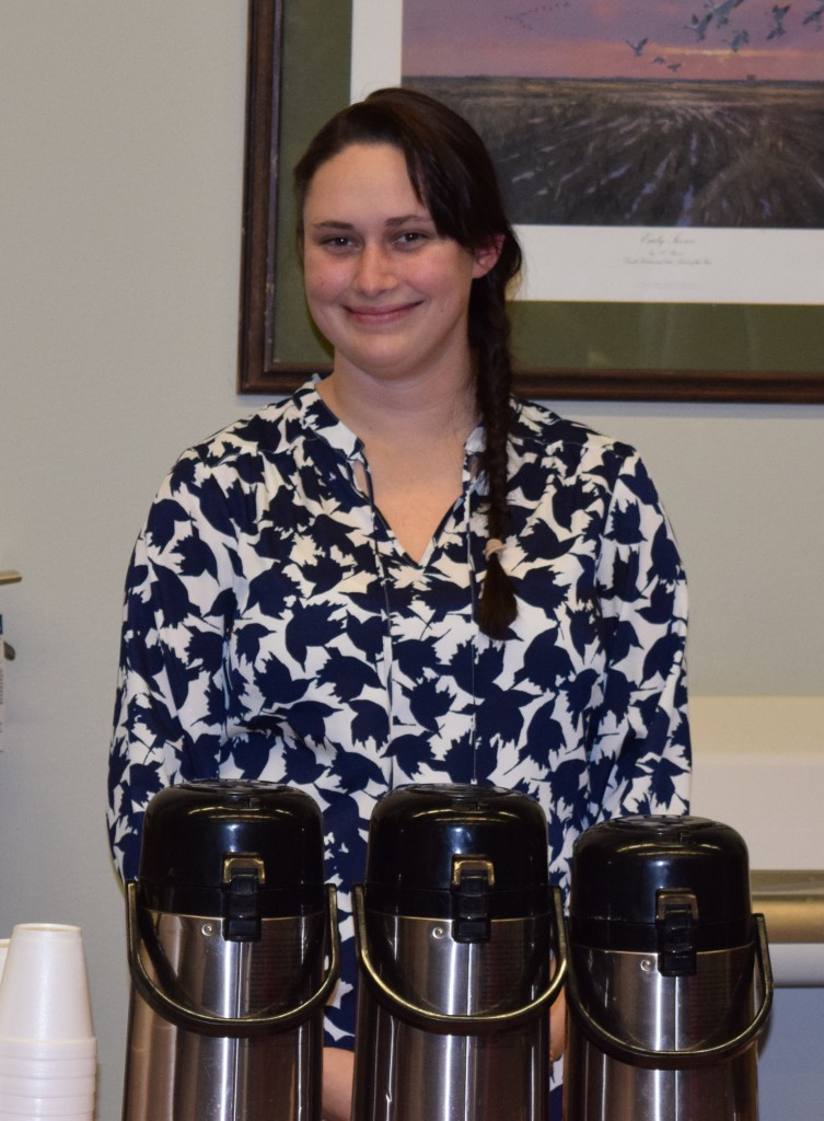 Rachel Withrow, Owner Crooked Door Coffee House, serving coffee to attendees.